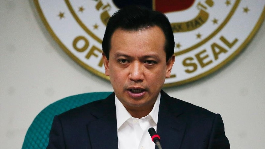 Philippine Sen. Antonio Trillanes IV speaks at a news conference at the Philippine Senate Thursday, Feb. 16, 2017 in suburban Pasay city, south of Manila, Philippines. Trillanes pressed Philippine President Rodrigo Duterte Thursday to publicly release details of his bank accounts to disprove allegations that he had large sums of undeclared money. (AP Photo/Bullit Marquez)