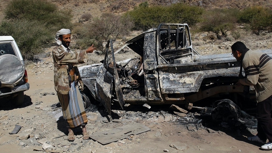 This undated handout photo from the Al-Karama Foundation, a Geneva-based non-governmental human rights organization, shows one of the cars that was hit by a drone strike in December 2013, that killed the son of Abdullah Mabkhout al-Ameri and eleven others, when it hit a convoy  which was allegedly a wedding procession. Al-Ameri and several family members including a son who belonged to al-Qaida were killed in a Jan. 29, 2017, US raid in the village. The raid, which left at least 25 Yemenis dead and a US Navy Seal, showed how difficult it is to tell who is al-Qaida in a country where the militants are mingled with tribes and are fighting on the same side as the government against the rebels. (Farouk al-Sharani, Al-Karama Foundation, via AP)