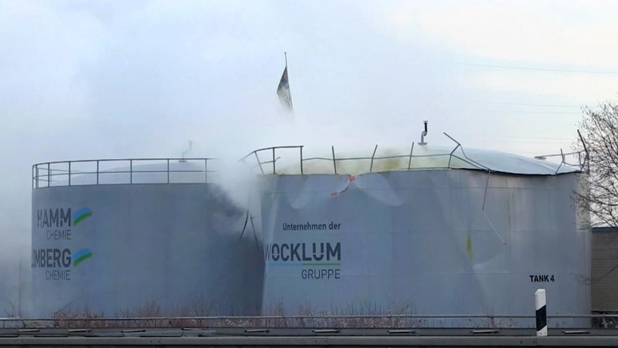 Sulfuric acid leaks out of a tank in Oberhausen, Germany, Thursday, Feb. 16 2017. The tank containing the acid on the premises of a chemical company started leaking on Thursday morning. (Telenewsnetwork/dpa via AP)