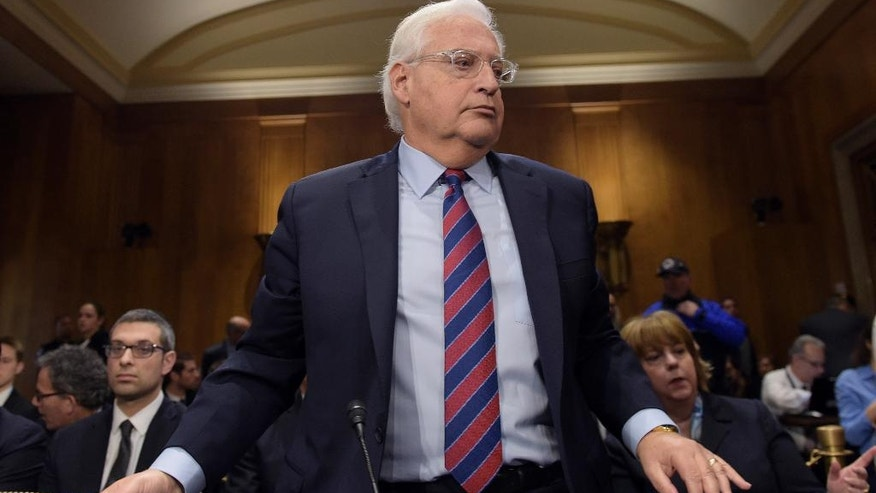 David Friedman, nominated to be U.S. Ambassador to Israel, prepares to leave a hearing room on Capitol Hill in Washington, Thursday, Feb. 16, 2017, during a break in his confirmation hearing before the Senate Foreign Relations Committee. (AP Photo/Susan Walsh)