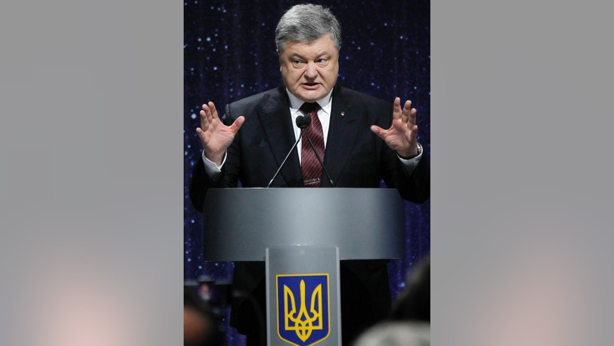 "Ukrainian President Petro Poroshenko speaks at the ceremony commemorating the fallen Heroes of the ""Heavenly Hundred"" in Kiev, Ukraine, Thursday, Feb. 16, 2017. The ""Heavenly Hundred"" is what Ukrainians in Kiev call those who died during months of anti-government protests in 2013 and 2014. (AP Photo/Sergei Chuzavkov)"