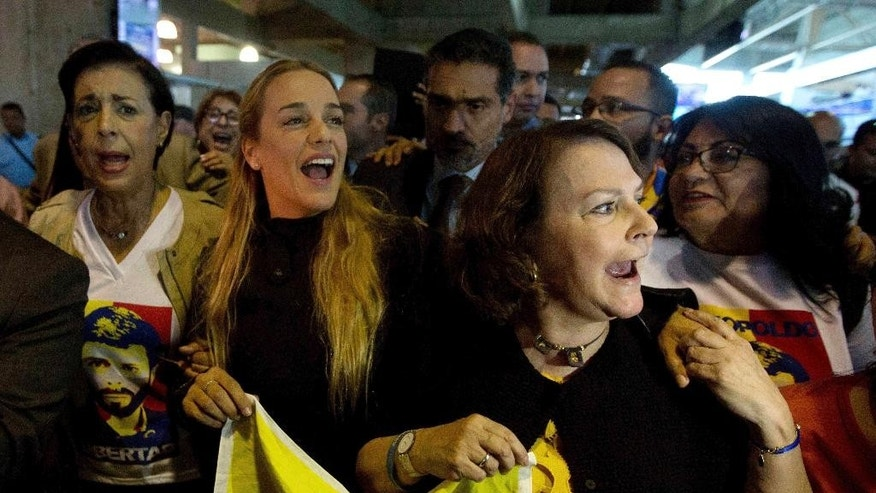 "Antonieta Mendoza, mother of jailed opposition leader Leopoldo Lopez, from left, Lilian Tintori, Lopez's wife, and Mitzy Capriles, wife of jailed Caracas Mayor Antonio Ledezma, chant ""Freedom"" upon their arrival to the Simon Bolivar International Airport, in Maiquetia, Venezuela, Thursday, Feb. 16, 2017. U.S. President Donald Trump's surprise Oval Office meeting Wednesday night with Tintori sent shockwaves on social media in Venezuela but it remains to be seen if his willingness to quickly take up the cause of the opposition will help or hamper regional efforts to resolve the nation's political and economic crisis (AP Photo/Fernando Llano)"
