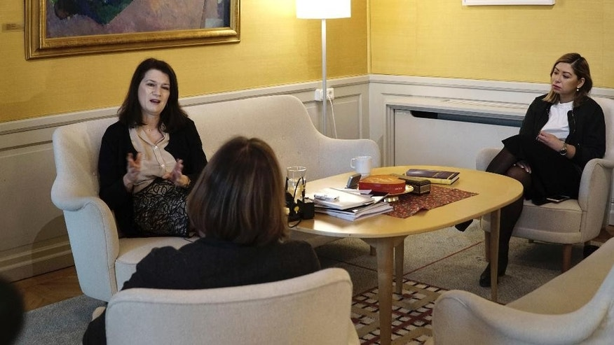 Sweden's Minister for EU affairs and trade, Ann Linde, centre,  sits for an interview with The Associated Press, in Stockholm, Thursday, Feb. 16, 2017. Linde warned that securing a new partnership between Britain and its former EU partners will take years. British Prime Minister Theresa May plans to invoke Article 50 of the key EU treaty, starting the two-year exit process, by March 31. (AP Photo/David Keyton)