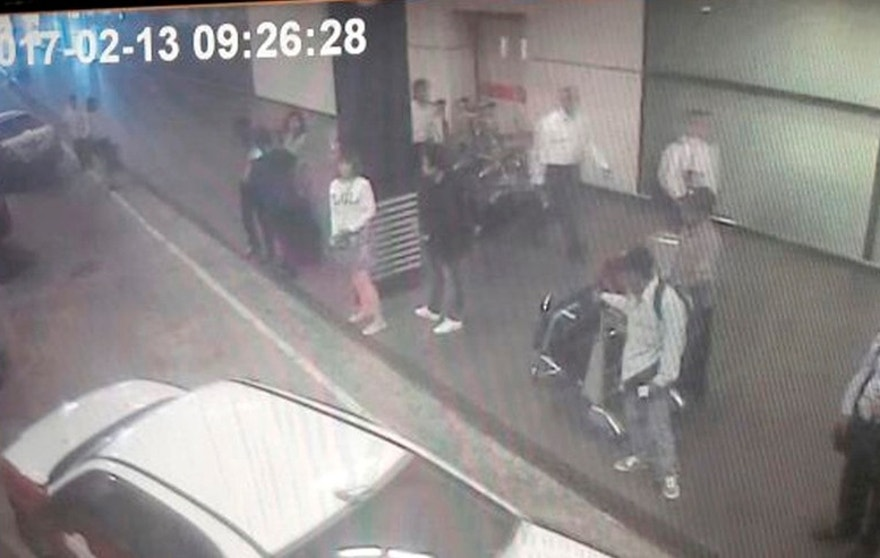 This image provided by Star TV on Wednesday, Feb. 15, 2017, of closed circuit television footage from Monday, Feb 13, 2017, shows a woman, center in white, at Kuala Lumpur International Airport in Sepang, Malaysia, who police say was arrested Wednesday in connection with the death of Kim Jong Nam, the half brother of North Korean leader Kim Jong Un. (Star TV via AP)
