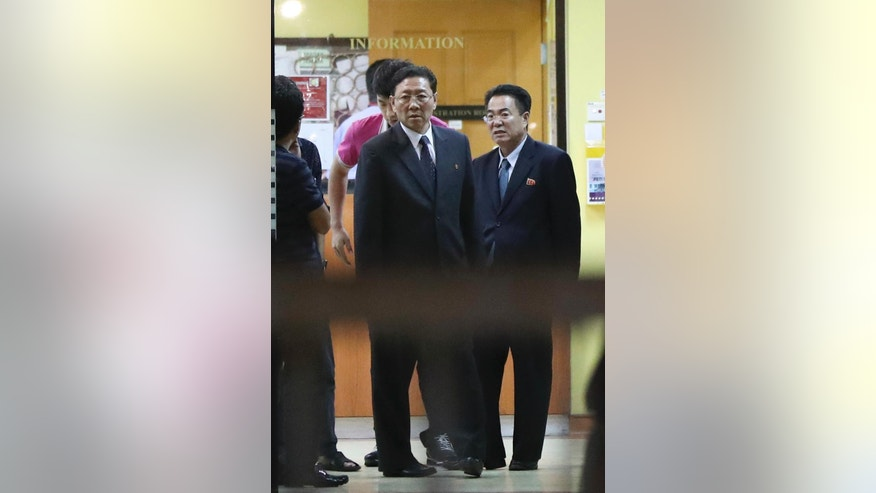 North Korean Ambassador to Malaysia Kang Chol, center, stands at the entrance as he prepares to leave the forensic department at a hospital in Kuala Lumpur, Malaysia, Wednesday, Feb. 15, 2017. News of the apparent assassination of North Korean leader Kim Jong Un's half brother rippled across Asia on Wednesday as Malaysian investigators scoured airport surveillance video for clues about two female suspects and rival South Korea offered up a single, shaky motive: paranoia. (AP Photo/Vincent Thian)