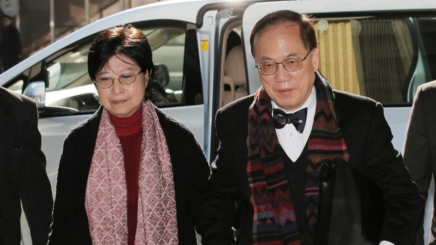 Donald Tsang, right, former leader of Hong Kong, and his wife Selina arrive at the magistrates' court in Hong Kong, Wednesday, Feb. 15, 2017. The former Hong Kong leader faces misconduct charges over a luxury apartment in mainland China, making him the highest-ranking official to be formally arrested by anti-corruption investigators in the Asian business hub. (AP Photo/Kin Cheung)