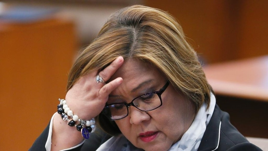 "In this Feb. 13, 2017 photo, Philippine Sen. Leila de Lima takes her seat during a session in the Philippine Senate in suburban Pasay city, south of Manila, Philippines. Philippine justice secretary said Friday, Feb. 17, 2017, criminal charges have been filed against the opposition senator allegedly receiving money from detained drug lords in a move that can lead to the arrest of one of the president's most vocal critics. De Lima has denied the charges as ""political persecution"" by President Rodrigo Duterte's administration. (AP Photo/Bullit Marquez)"