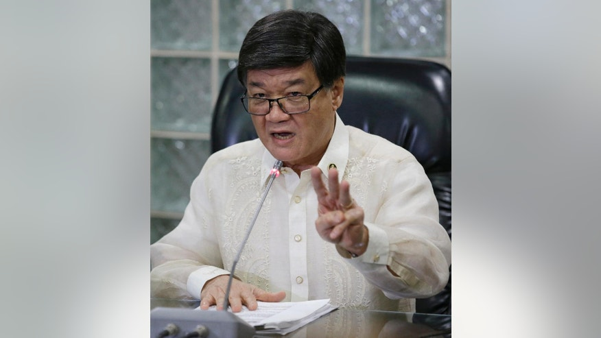 Philippine Justice Secretary Vitaliano Aguirre II gestures during a press conference in Manila, Philippines, Friday, Feb. 17, 2017. Aguirre said state prosecutors have filed three criminal charges against opposition Sen. Leila de Lima for allegedly receiving money from detained drug lords in a move that can lead to the arrest of one of the president's most vocal critics. (AP Photo/Aaron Favila)