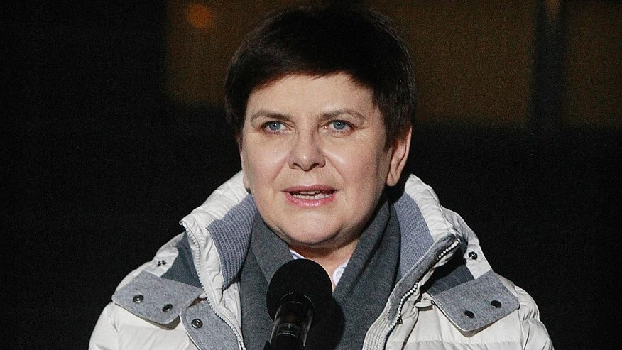 Poland's Prime Minister Beata Szydlo speaks as she leaves hospital after being hospitalized for a week following a car crash in Warsaw, Poland, Friday Feb. 17, 2017. Szydlo suffered minor injuries when the car she was traveling in swerved to avoid another car and hit a tree in the Polish town of Oswiecim on Feb. 10, 2017. (AP Photo/Czarek Sokolowski)