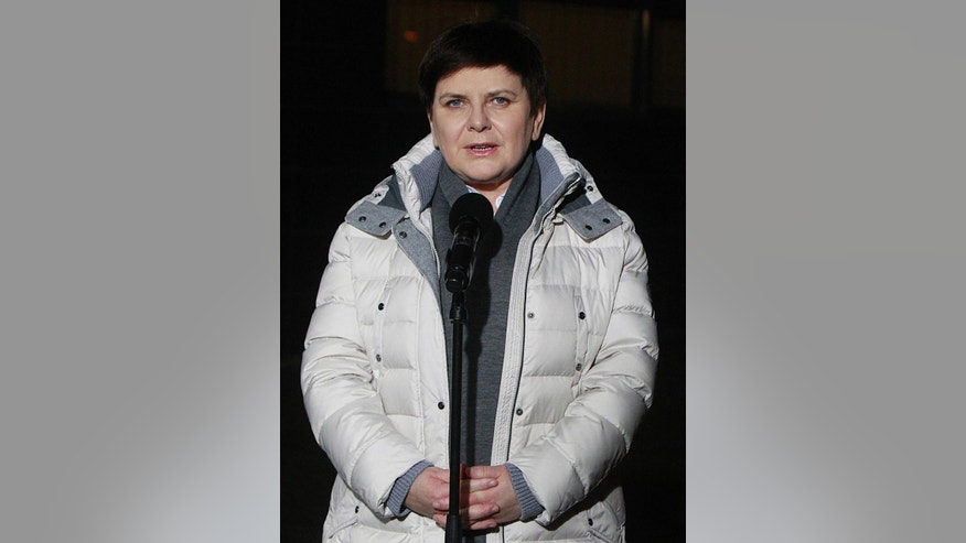 Poland's Prime Minister Beata Szydlo leaves hospital after being hospitalized for a week following a car crash in Warsaw, Poland, Friday Feb. 17, 2017. Szydlo suffered minor injuries when the car she was traveling in swerved to avoid another car and hit a tree in the Polish town of Oswiecim on Feb. 10, 2017. (AP Photo/Czarek Sokolowski)