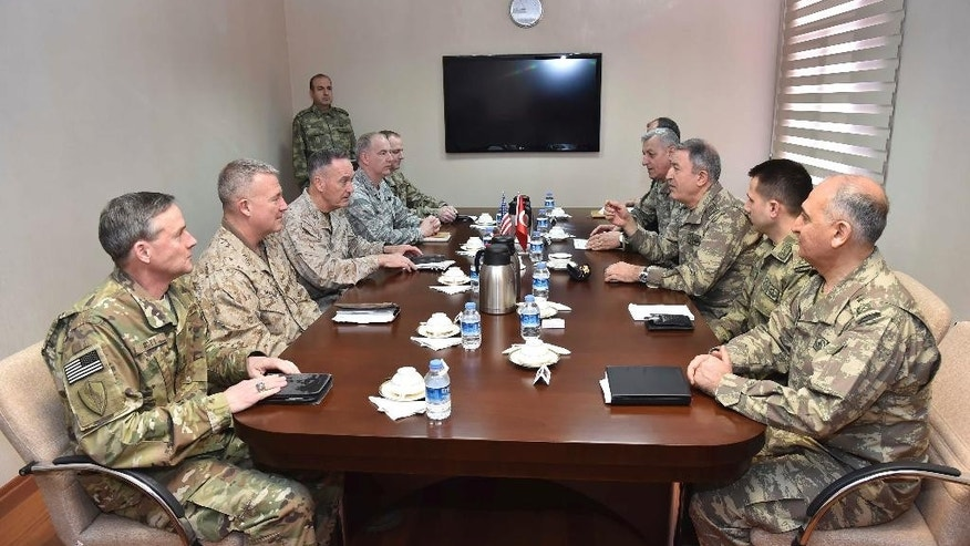 "The U.S. chairman of the Joint Chiefs of Staff, Gen. Joseph Dunford, third left, and Turkey's Chief of Staff Gen. Hulusi Akar, third right, talk during a meeting in Incirlik Airbase in Adana, Turkey, Friday, Feb. 17, 2017. Turkey's military says the Turkish and U.S. chiefs of staff have ""confirmed"" the need to fight terror groups in Syria and Iraq, including the Islamic State group and Kurdish militants.(Turkish Military, Pool Photo via AP)"