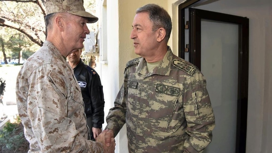 "The U.S. chairman of the Joint Chiefs of Staff, Gen. Joseph Dunford, left, and Turkey's Chief of Staff Gen. Hulusi Akar talk during a meeting in Incirlik Airbase in Adana, Turkey, Friday, Feb. 17, 2017. Turkey's military says the Turkish and U.S. chiefs of staff have ""confirmed"" the need to fight terror groups in Syria and Iraq, including the Islamic State group and Kurdish militants. (Turkish Military, Pool Photo via AP)"