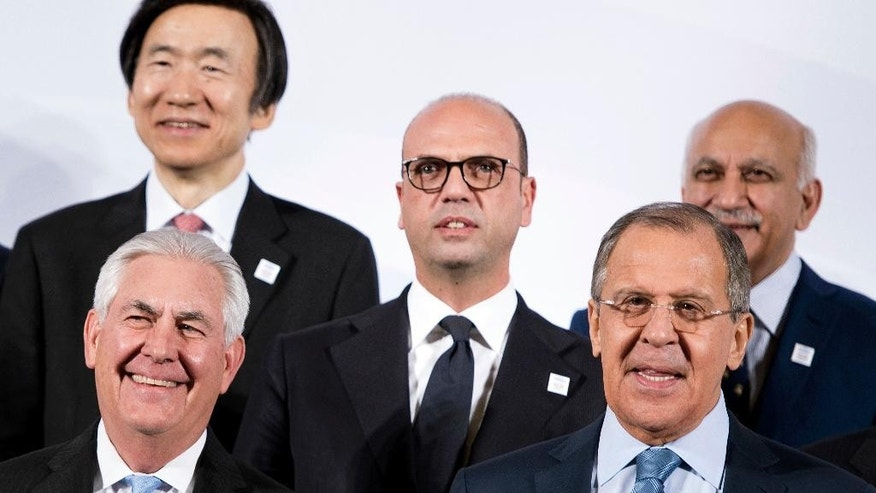 US Secretary of State Rex Tillerson, front left, and Russia's Foreign Minister Sergey Lavrov, front right, pose with, back row from left, South Korea Foreign Minister Yun Byung-Se, Italy Foreign Minister Angelino Alfano and India Foreign Minister Mallika Joseph Akbar at the G20 foreign ministers meeting group photo at the World Conference Center in Bonn, Germany, Thursday, Feb. 16, 2017. Foreign ministers from 20 of the world's leading nations met Thursday in the former German capital to discuss current conflicts and ways to prevent future crises against a backdrop of uncertainty among allies and adversaries about the direction of U.S. foreign policy. (AP Photo/Brendan Smialowski, Pool)