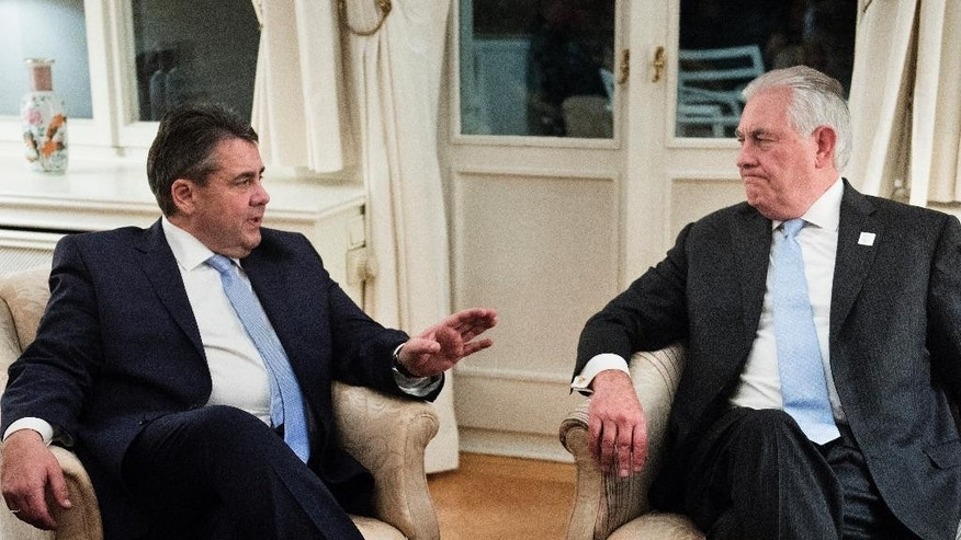 Germany's Foreign Minister, Sigmar Gabriel, left, and US Secretary of State, Rex Tillerson, talk after a dinner with G-20 ministers at the Villa Hammerschmidt Thursday, Feb. 16, 2017 in Bonn, Germany. Foreign ministers from 20 of the world's leading nations met Thursday in the former German capital to discuss current conflicts and ways to prevent future crises against a backdrop of uncertainty among allies and adversaries about the direction of U.S. foreign policy. (AP Photo/Brendan Smialowski, Pool)