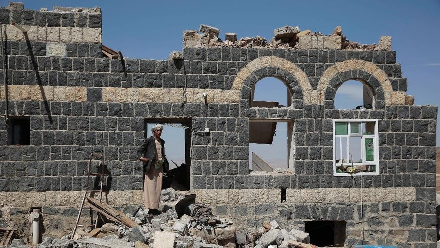 A man stands on the rubble of a house destroyed by a Saudi-led airstrike in the outskirts of Sanaa, Yemen, Thursday, Feb. 16, 2017. At least one Saudi-led airstrike near Yemen's rebel-held capital killed at least five people on Wednesday, the country's Houthi rebels and medical officials said. (AP Photo/Hani Mohammed)