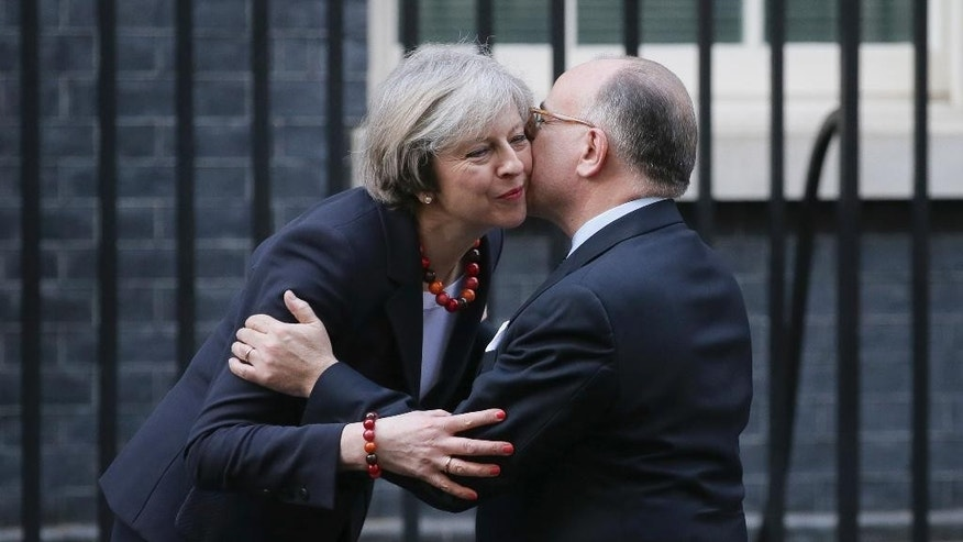 Britain's Prime Minister Theresa May greets French Prime Minister Bernard Cazeneuve at 10 Downing Street in London, Friday Feb. 17, 2017.  Cazeneuve is in London for bilateral discussions.(AP Photo/Tim Ireland)