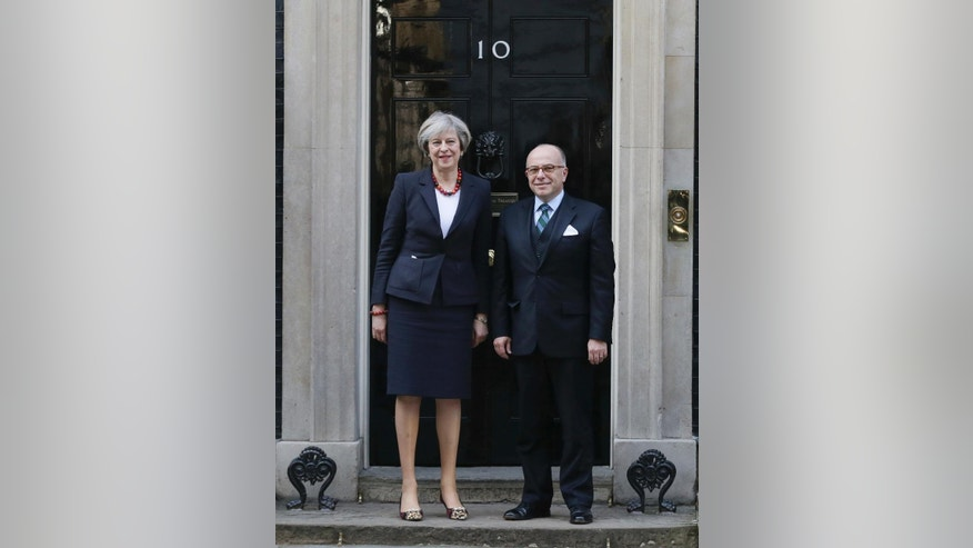 British Prime Minister Theresa May greets French Prime Minister Bernard Cazeneuve at 10 Downing Street in London, Friday Feb. 17, 2017.  Cazeneuve is in London for bilateral discussions.(AP Photo/Tim Ireland)