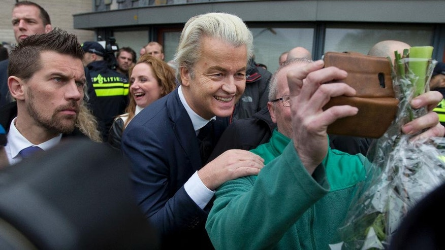 "Firebrand int-islam lawmaker Geert Wilders, center, poses for a picture during an election campaign stop in Spijkenisse, near Rotterdam, Netherlands Saturday Feb. 18, 2017. Now, as a March 15 parliamentary election looms, the political mood is turning inward as Wilders dominates polls with an isolationist manifesto that calls for the Netherlands ""to be independent again. So out of the EU."" (AP Photo/Peter Dejong)"