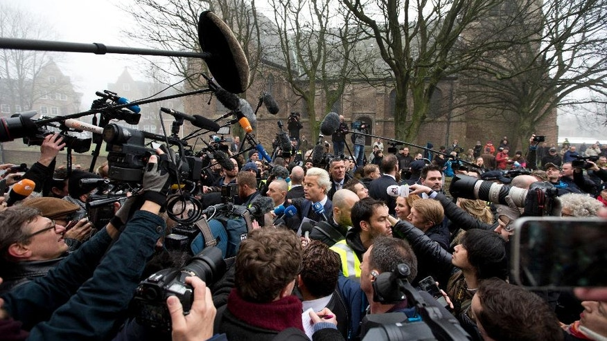 "Firebrand int-islam lawmaker Geert Wilders, center, talks to the media during an election campaign stop in Spijkenisse, near Rotterdam, Netherlands Saturday Feb. 18, 2017. Now, as a March 15 parliamentary election looms, the political mood is turning inward as Wilders dominates polls with an isolationist manifesto that calls for the Netherlands ""to be independent again. So out of the EU."" (AP Photo/Peter Dejong)"
