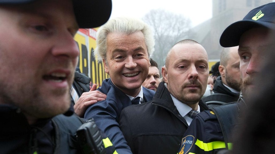 "Firebrand int-islam lawmaker Geert Wilders greets well-wishers during an election campaign stop in Spijkenisse, near Rotterdam, Netherlands, Saturday Feb. 18, 2017. Now, as a March 15 parliamentary election looms, the political mood is turning inward as Wilders dominates polls with an isolationist manifesto that calls for the Netherlands ""to be independent again. So out of the EU."" (AP Photo/Peter Dejong)"