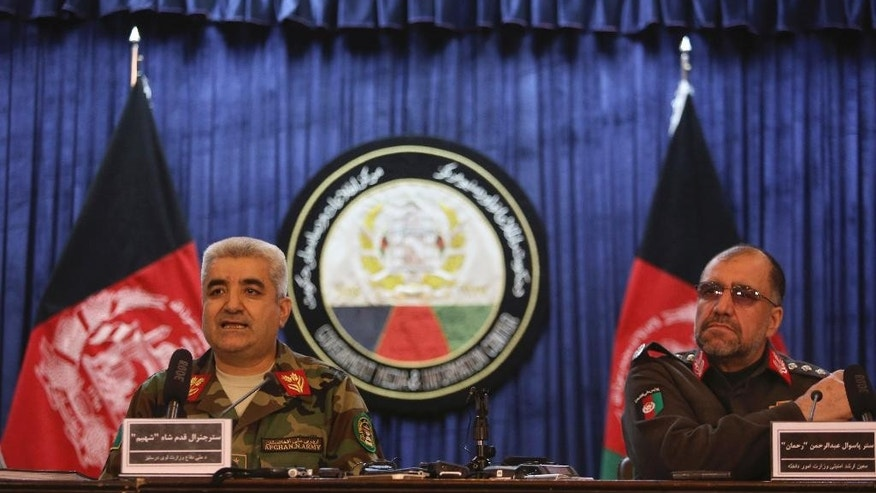Afghan Army Chief of Staff General Qadam Shah Shahim, left, and Deputy Interior Minister General Abdul Rahman Rahman, give a news conference, in Kabul, Afghanistan, Saturday, Feb. 18, 2017. The Afghan government has summoned Pakistan's ambassador in protest of recent shelling in Afghanistan's eastern provinces. (AP Photo/Rahmat Gul)
