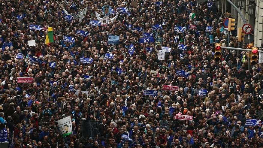 Thousands of people march to demand Spain's government to increase its efforts to take in refugees who have fled the war in Syria and other violent conflicts in Barcelona, Spain, Saturday, Feb. 18, 2017. Spain has taken in just 1,100 refugees of the over 17,000 it has pledged to accept. (AP Photo/Manu Fernandez)