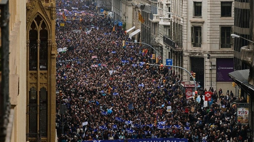 "Thousands of people march to demand Spain's government to increase its efforts to take in refugees who have fled the war in Syria and other violent conflicts in Barcelona, Spain, Saturday, Feb. 18, 2017. Spain has taken in just 1,100 refugees of the over 17,000 it has pledged to accept. Banner reads in Catalan: ""Enough Excuses! Take Them In Now!"". (AP Photo/Manu Fernandez)"