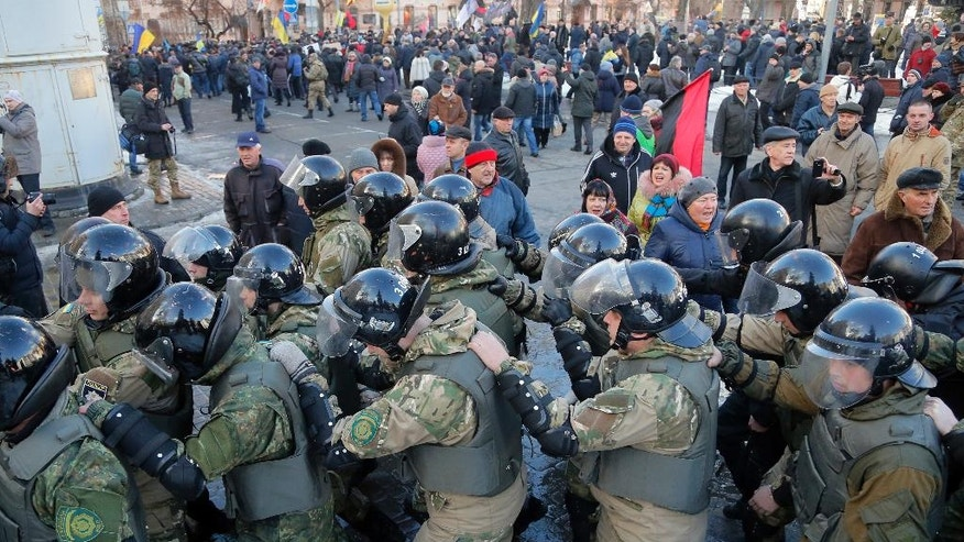 Riot police block the approach to the President's Office at a protest rally in Kiev, Ukraine, Sunday, Feb. 19, 2017. Protesters were demanding a stop to trade relations with Russia-occupied Ukrainian territories. (AP Photo/Efrem Lukatsky)
