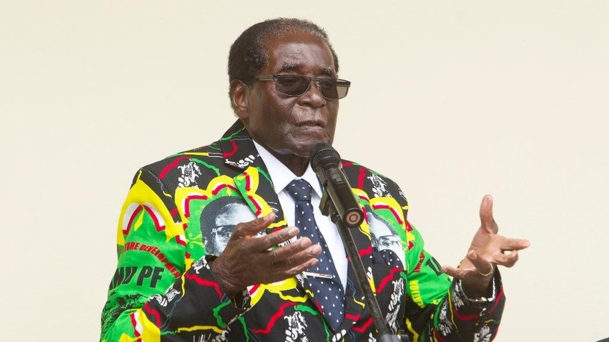 In this photo taken Dec. 17, 2016, Zimbabwean President Robert Mugabe addresses party supporters at a conference in Masvingo, Zimbabwe. As the world's oldest head of state approaches his 93rd birthday on Tuesday Feb. 21, 2017. Zimbabwe has been planning a party for thousands of people. (AP Photo/Tsvangirayi Mukwazhi)