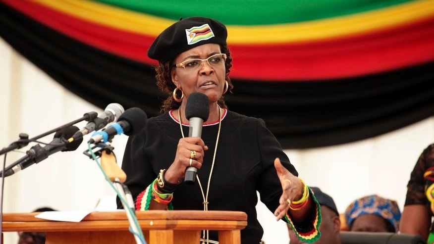 Zimbabwean first lady Grace Mugabe addresses party supporters at an event on the outskirts of Harare, Friday, Feb. 17, 2017. Grace Mugabe warned those of her husband's generation that they can't take power because they are old, too. As the world's oldest head of state approaches his 93rd birthday on Tuesday Feb. 21, 2017. Zimbabwe has been planning a party for thousands of people. (AP Photo/Tsvangirayi Mukwazhi)