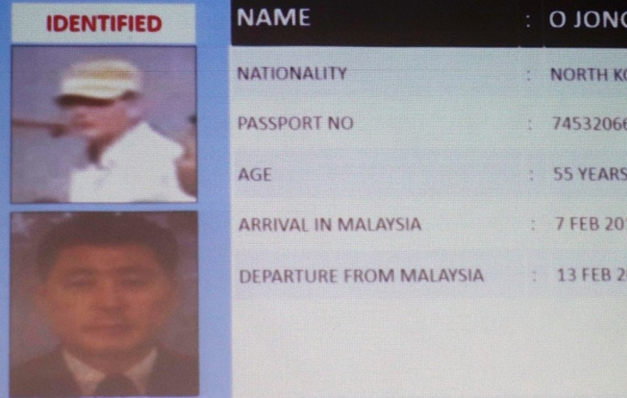 Information about one of the suspects North Korean O Jong Gil, is displayed during a press conference by Malaysia Deputy National Police Chief Noor Rashid Ibrahim, not show, at the Bukit Aman national police headquarters in Kuala Lumpur, Malaysia, Sunday, Feb. 19, 2017. Malaysia's police are looking for four more North Korean suspects who they say left the country the same day the North Korean leader's brother died after being attacked at the Kuala Lumpur airport. (AP Photo/Vincent Thian)