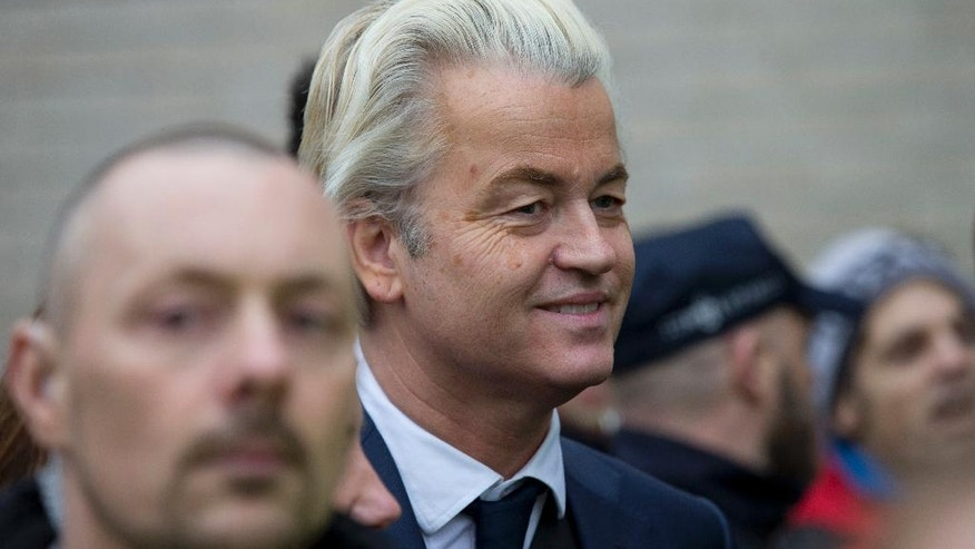 "Firebrand int-islam lawmaker Geert Wilders smiles during an election campaign stop in Spijkenisse, near Rotterdam, Netherlands Saturday Feb. 18, 2017. Now, as a March 15 parliamentary election looms, the political mood is turning inward as Wilders dominates polls with an isolationist manifesto that calls for the Netherlands ""to be independent again. So out of the EU."" (AP Photo/Peter Dejong)"