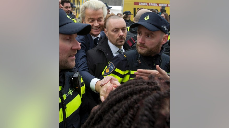 "Firebrand int-islam lawmaker Geert Wilders greets well-wishers during an election campaign stop in Spijkenisse, near Rotterdam, Netherlands Saturday Feb. 18, 2017. Now, as a March 15 parliamentary election looms, the political mood is turning inward as Wilders dominates polls with an isolationist manifesto that calls for the Netherlands ""to be independent again. So out of the EU."" (AP Photo/Peter Dejong)"