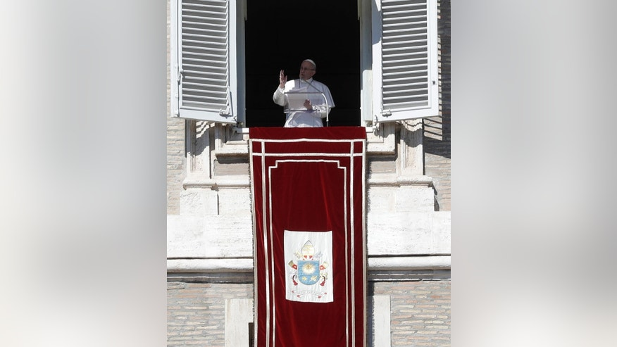 Pope Francis delivers his message from his studio window overlooking St. Peter's Square during his Angelus prayer, at the Vatican, Sunday, Feb. 19, 2017. (AP Photo/Alessandra Tarantino)