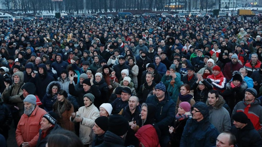 People gather for a protest rally in downtown Minsk, Belarus, Friday, Feb. 17, 2017. Several thousand demonstrators gathered to protest against a law that imposes a tax on those not in full-time employment. (AP Photo/Sergei Grits)