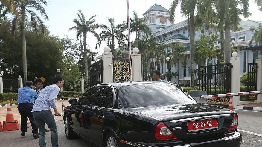 North Korean ambassador to Malaysia's car enters Malaysian Foreign Ministry in Putrajaya, Malaysia, Monday, Feb. 20, 2017. Since the death of Kim Jong Nam, the North Korean ruler's outcast half brother, last week, authorities have been trying to piece together details of what appeared to be an assassination. (AP Photo) MALAYSIA OUT