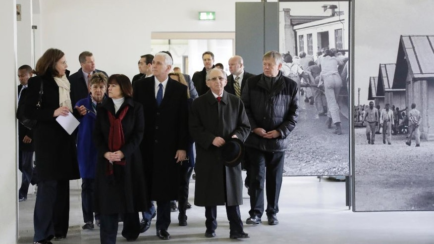 U.S. Vice President Mike Pence, fourth from left, and his wife Karen, third from left, visit the memorial site in the former Nazi concentration camp in Dachau near Munich, southern Germany, Sunday, Feb. 19, 2017, one day after he attended the Munich Security Conference. (AP Photo/Matthias Schrader)