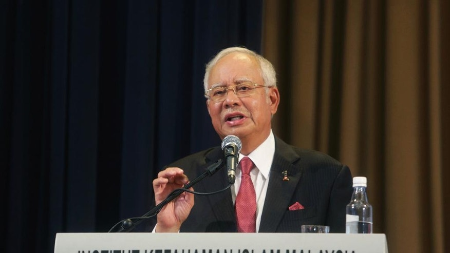 "Malaysian Prime Minister Najib Razak speaks during an International Conference on Religion and Sustainability of Civilization at Institute of Islamic Understanding Malaysia in Kuala Lumpur, Malaysia, Monday, Feb. 20, 2017. Najib said Malaysia had no reason to ""paint the North Koreans in a bad light"" but added, ""We expect them to understand that we apply the rule of law in Malaysia. (AP Photo)"