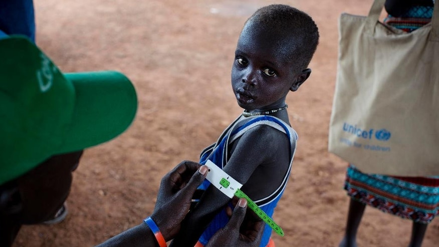 In this photo taken Thursday, Oct. 20, 2016 and released by UNICEF, a boy has his arm measured to see if he is suffering from malnutrition during a nutritional assessment at an emergency medical facility supported by UNICEF in Kuach, on the road to Leer, in South Sudan. Famine has been declared Monday, Feb. 20, 2017 in two counties of South Sudan, according to an announcement by the South Sudan government and three U.N. agencies, which says the calamity is the result of prolonged civil war and an entrenched economic crisis that has devastated the war-torn East African nation. (Kate Holt/UNICEF via AP)