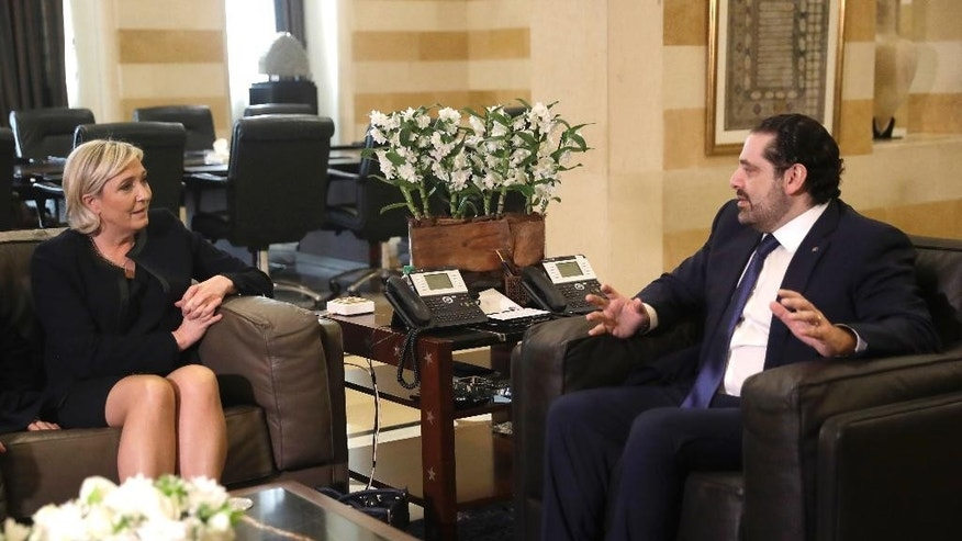 Lebanese prime minister Saad Hariri, right, meets with far right leader and presidential candidate Marine Le Pen, left, at the government palace, in Beirut, Lebanon, Monday, Feb. 20, 2017. Le Pen has arrived in Beirut to meet with the Lebanese head of state and leading Christian figures. The National Front leader is hoping to burnish her credentials as a defender of Christians in the Middle East, ahead of France's April 23 presidential elections. (AP Photo/Hussein Malla)