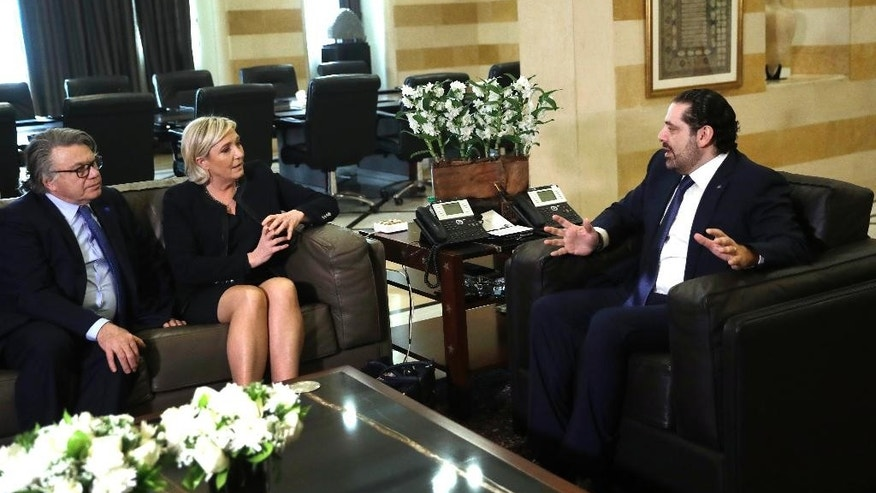 Lebanese prime minister Saad Hariri, right, meets with far right leader and presidential candidate Marine Le Pen, center, and French lawmaker Gilbert Collard, left, at the government palace, in Beirut, Lebanon, Monday, Feb. 20, 2017. Le Pen has arrived in Beirut to meet with the Lebanese head of state and leading Christian figures. The National Front leader is hoping to burnish her credentials as a defender of Christians in the Middle East, ahead of France's April 23 presidential elections. (AP Photo/Hussein Malla)