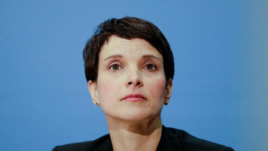 FILE - In this file photo dated Friday, Dec. 16, 2016, AfD (Alternative for Germany) chairwoman Frauke Petry attends a news conference of the party in Berlin.  Germany's most prominent nationalist politician Frauke Petry has held talks with Russian lawmakers, including senior members of President Vladimir Putin's United Russia party, to discuss cooperation between German and Russian regional assemblies, according to a party statement issued Monday Feb. 20, 2017. (AP Photo/Markus Schreiber, FILE)