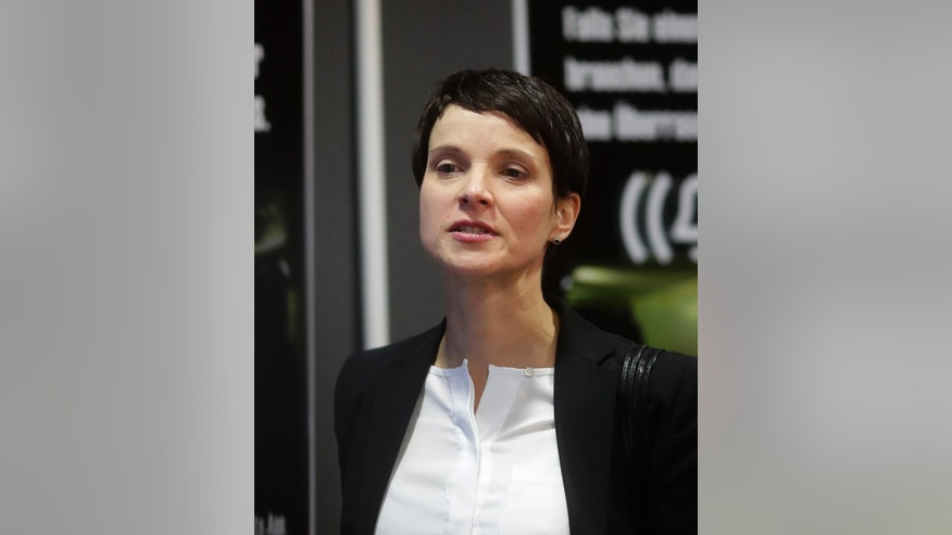 FILE - In this file photo dated Friday, Dec. 16, 2016, AfD (Alternative for Germany) chairwoman Frauke Petry arrives for a news conference in Berlin, Friday, Dec. 16, 2016.  Germany's most prominent nationalist politician Frauke Petry has held talks with Russian lawmakers, including senior members of President Vladimir Putin's United Russia party, to discuss cooperation between German and Russian regional assemblies, according to a party statement issued Monday Feb. 20, 2017.(AP Photo/Markus Schreiber, FILE)
