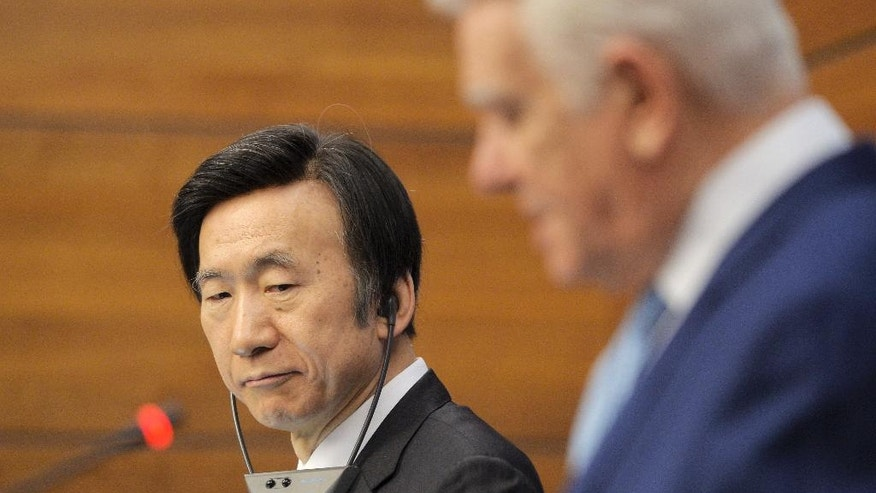 South Korean Foreign Minister Yun Byung Se, left, listens to Romanian counterpart Teodore Melescanu during a joint media conference in Bucharest, Romania, Monday, Feb. 20, 2017. (AP Photo/Andreea Alexandru)