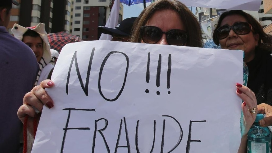 "An opposition presidential candidate Guillermo Lasso's supporter holds a sign that read in Spanish ""No to Fraud!"" during protest outside Ecuador's National Electoral Council to demand the official results of the presidential elections, in Quito, Ecuador, Monday, Feb. 20, 2017. The hand-picked candidate of socialist President Rafael Correa headed to victory in the opening round of Ecuador's presidential election, although it was uncertain whether he would get enough votes to avoid a runoff against Lasso, his nearest rival. (AP Photo/Dolores Ochoa)"