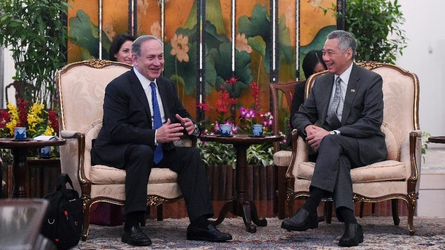 Israeli Prime Minister Benjamin Netanyahu, left, sits with Singaporean Prime Minister Lee Hsien Loong during a meeting at the Istana, or Presidential Palace, in Singapore, Monday, Feb. 20, 2017. (AP Photo/Joseph Nair)