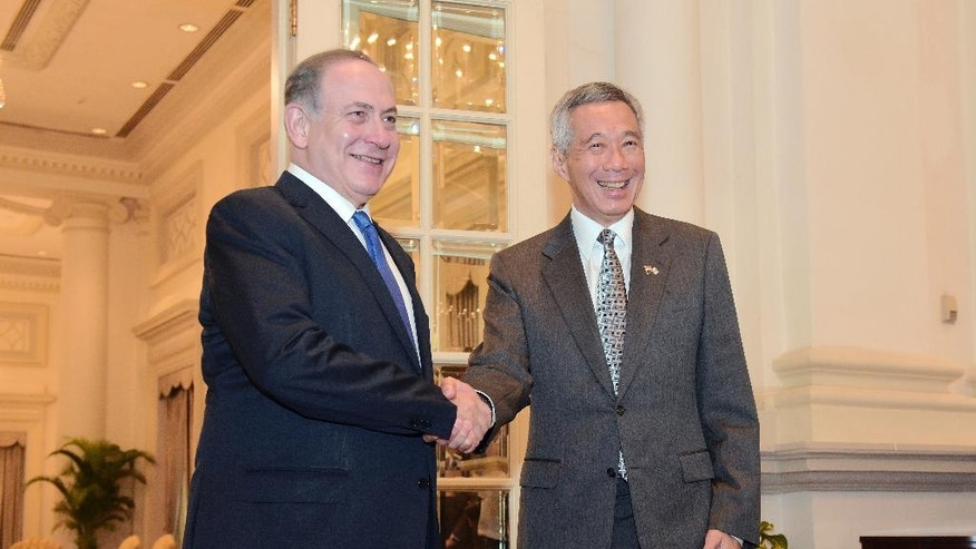 Israeli Prime Minister Benjamin Netanyahu, left, poses with Singapore Prime Minister Lee Hsien Loong for a photo at the Istana, or Presidential Palace, in Singapore, Monday, Feb. 20, 2017. (AP Photo/Joseph Nair)