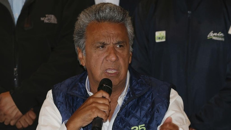 "Lenin Moreno, presidential candidate for the ruling party Alliance PAIS, center, speaks during a news conference where he said, ""no to violence"" as Ecuadoreans wait for results of the presidential race, in Quito, Ecuador, Monday, Feb. 20, 2017. The hand-picked candidate of President Rafael Correa, Moreno held an easy lead Monday in Ecuador's presidential election, though authorities said it might be a few more days before they determine if Moreno won enough votes to avoid a runoff against his nearest rival. (AP Photo/Dolores Ochoa)"