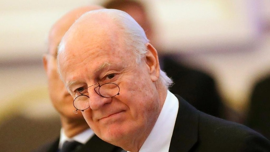 "FILE -- In this Jan. 23, 2017 file photo, U.N. Special Envoy for Syria Staffan de Mistura arrives to attend the talks on Syrian peace in Astana, Kazakhstan. Chief of staff to de Mistura, Michael Contet,  said Tuesday, Feb. 21, 2017, that their ""main guidance"" for the first intra-Syrian peace talks in 10 months will be a Security Council resolution that calls for political transition. Contet said that de Mistura is putting the ""finishing touches on arrangements"" for Thursday's start of talks in Geneva between government and opposition delegations, the fourth round since early last year. (AP Photo/Sergei Grits, File)"