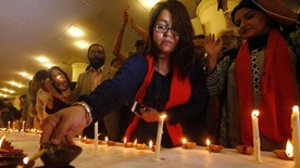 People light candles and oil lamps in tribute to the victims of Thursday's suicide attack at Lal Shahbaz Qalander shrine in Sehwanshrine, in Karachi, Pakistan, Saturday, Feb. 18, 2017. Pakistani authorities shut down a second key border crossing into Afghanistan, halting trade supplies to the neighboring landlocked country and increasing tensions between the two nations in the wake of a bloody suicide bombing at the beloved shrine in Pakistan, officials said Saturday. (AP Photo/Fareed Khan)